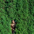 Gorgeous teen Taliah posing on the grass