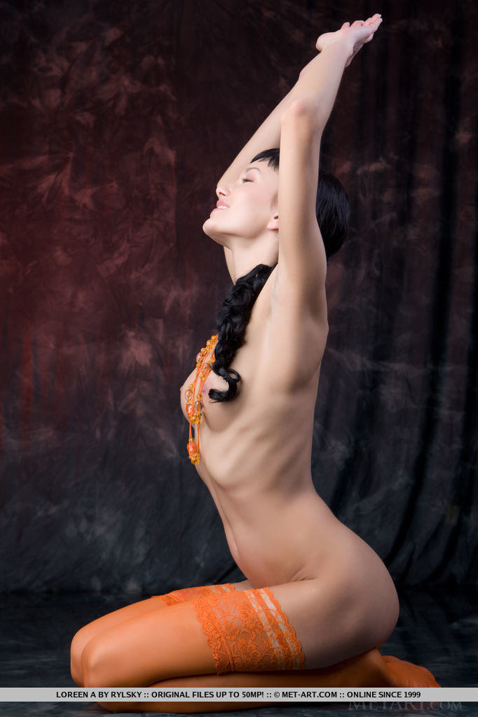 A bright orange sheer stocking accentuates Loreen A s long and slender physique, especially her svelte legs.