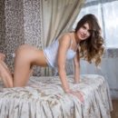 Brunette babe Luna Pica having a pleasant time alone in bed stroking her love hole