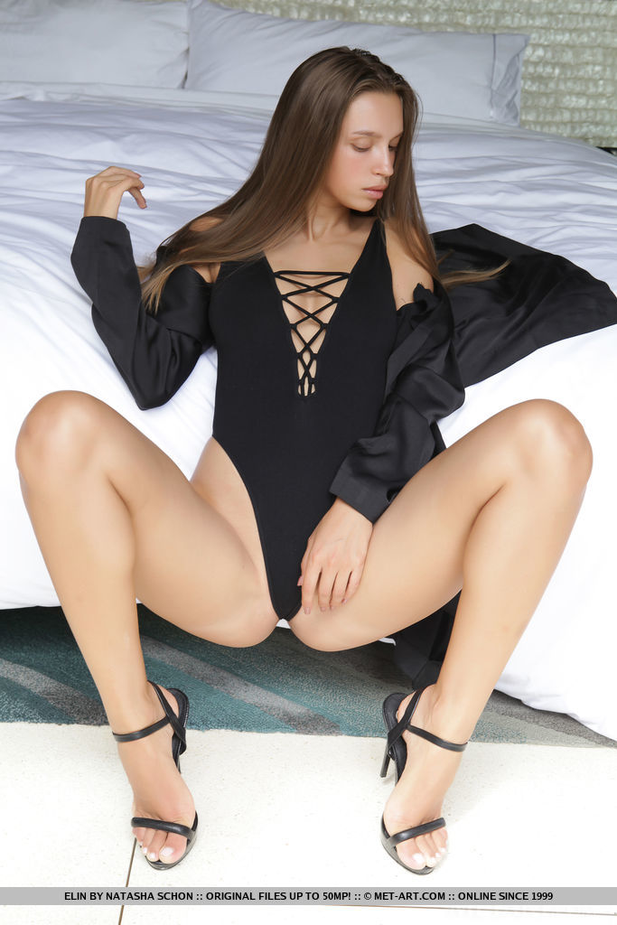 Elin s long and slender body look stunning in a black body suit and stiletto sandals that shows off her sexy legs