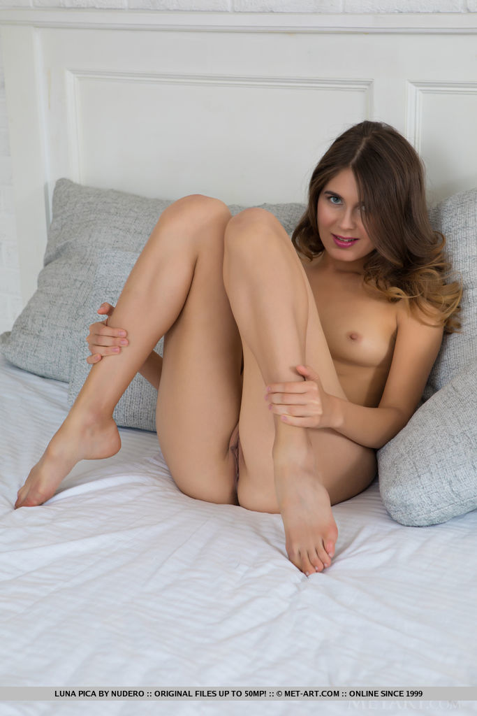 Luna Pica displays her sexy, naked body and small cup cakes on the bed.