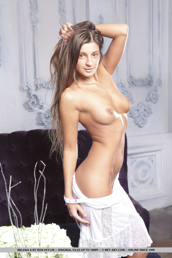 Melena A strips on the couch baring her smoking hot body.