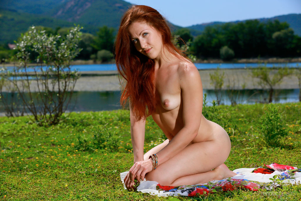 Redhead Callista Simon spreads her legs to show her roast beef pussy
