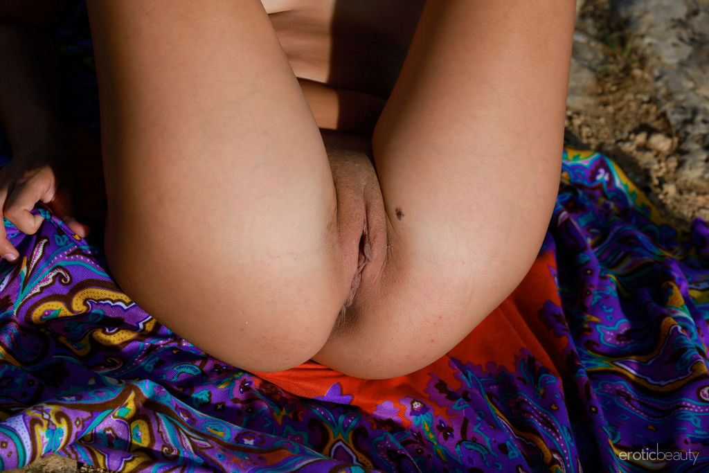 Romana A displays her perky tits and delectable pussy outdoors.