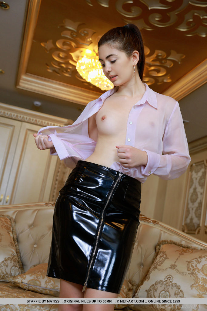 Staffie strips her latex skirt as she displays her delectable pussy.