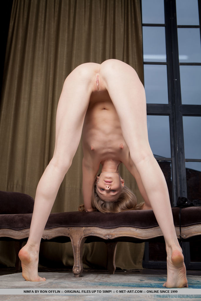 Top model Nimfa sensually strips on the couch as she bares her tight body.