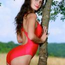 Yasmina strips her sexy red bikini outdoors as she bares her amazing body.