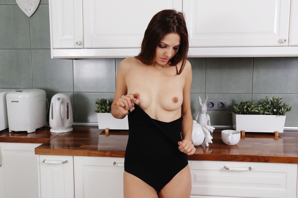 Alise Moreno enjoys her coffee before masturbating in the kitchen floor