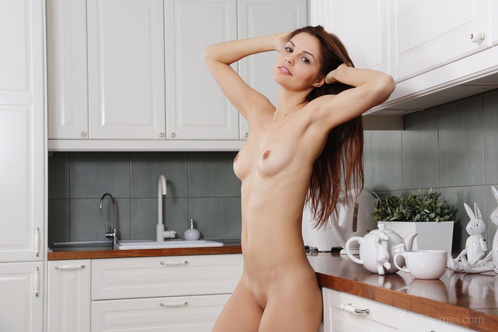 Alise Moreno enjoys her coffee before masturbating in the kitchen floor