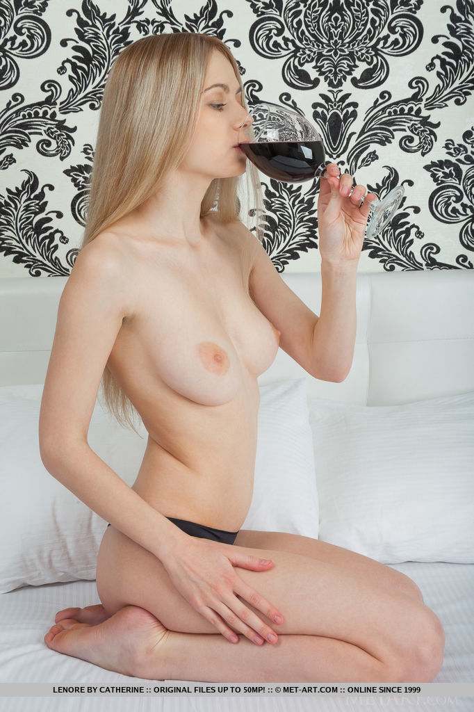 Aside from her stunning body, Lenore captures our attention with her youthful allure as she poses sensually on the bed.