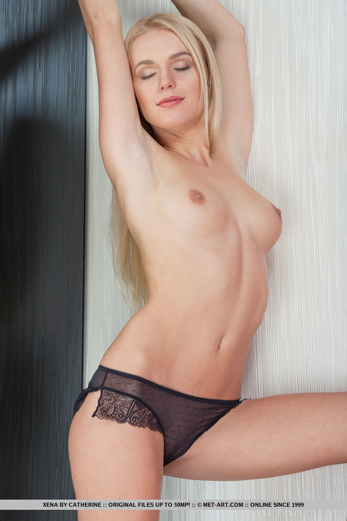 Blue-eyed Xena confidently poses in her sheer black panty that gives a naughty peek of her firm ass and svelte legs. Her artistic poses showing off long and slender frame.