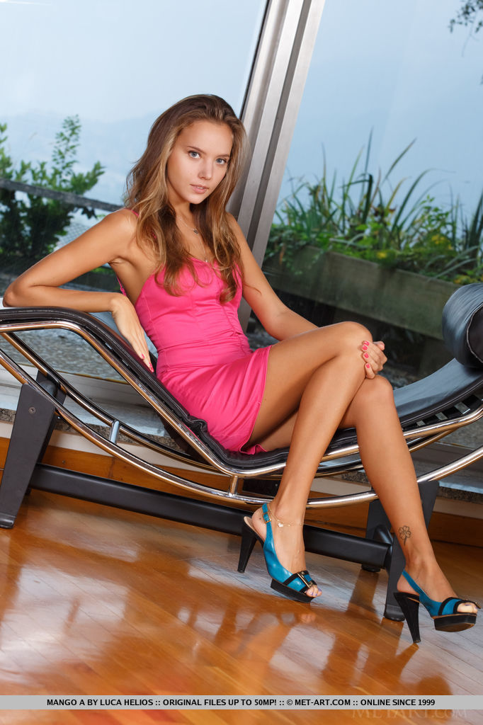 Mango A looks stunning in her vivid hot pink sun dress and bright teal and black heels to show off her long, slender legs.  She has a tendency to be a bit of an exhibitionsist as she stands in front of the window and  drops her dress to the floor.