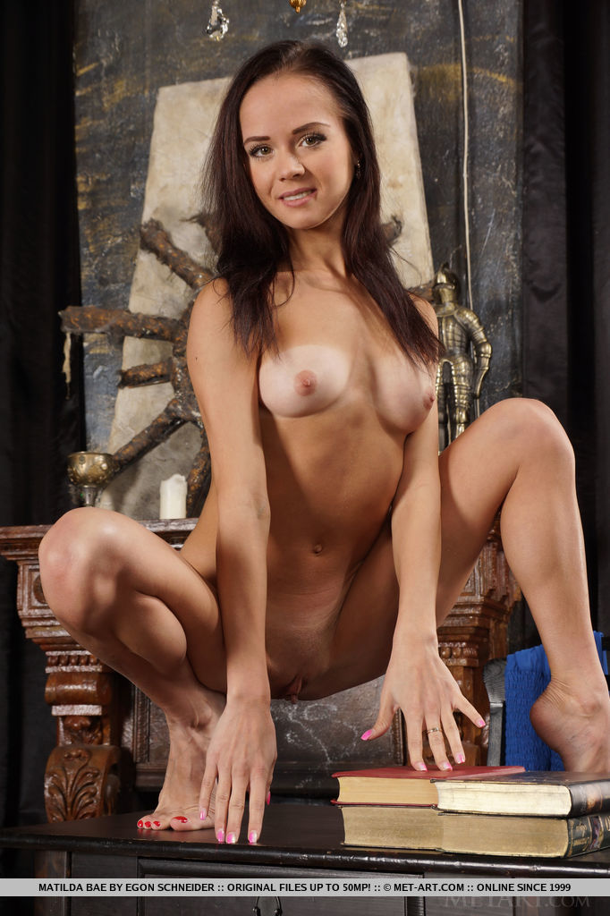 Matilda Bae shows off her acrobatic skills and flexible, athletic body and sprawls all over the living room.