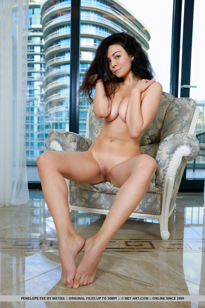 Newcomer Penelope Eve displays her gorgeous knockers and smooth fish lips on the chair.