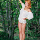 Redhead Violla A shows off her meaty ass and smooth twat outdoors.
