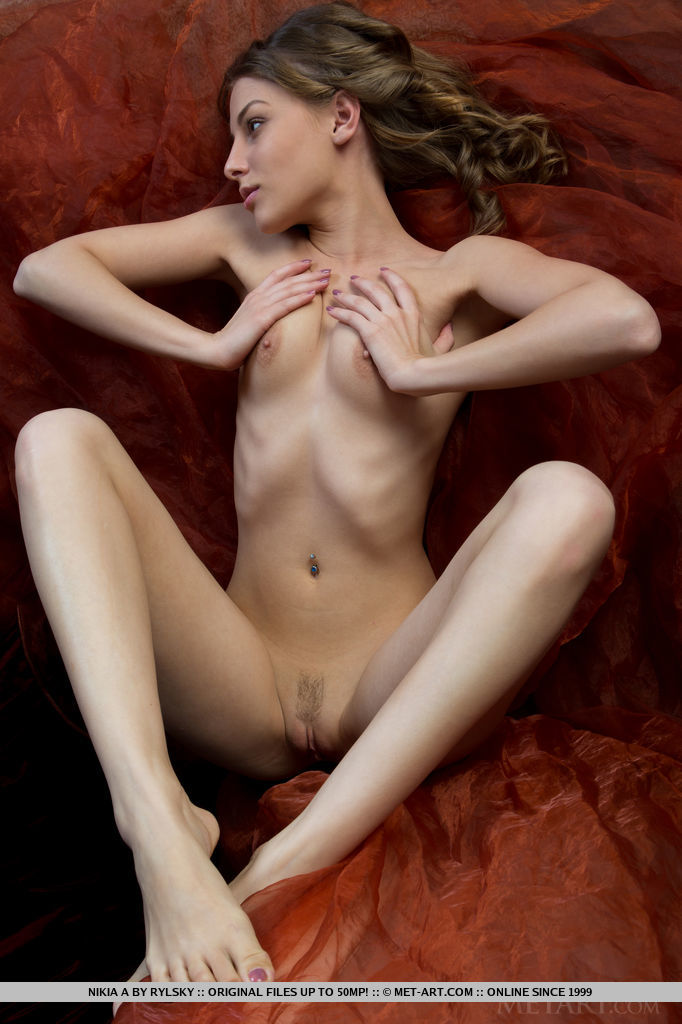 With her engaging smile and artistic poses, Nikia A is such a natural when it comes to posing naked for the camera.