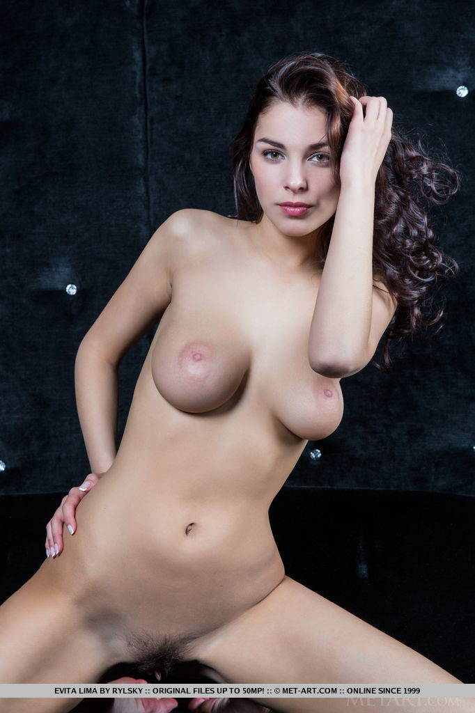Captivating and playfully posing naked, Evita Lima knows how to display her perfect assets in front of the camera. Round supple breasts, long sexy legs and a perfectly trimmed bush are just a few of her admired assets.