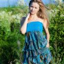 Busty teen blonde Alexandra D in the field