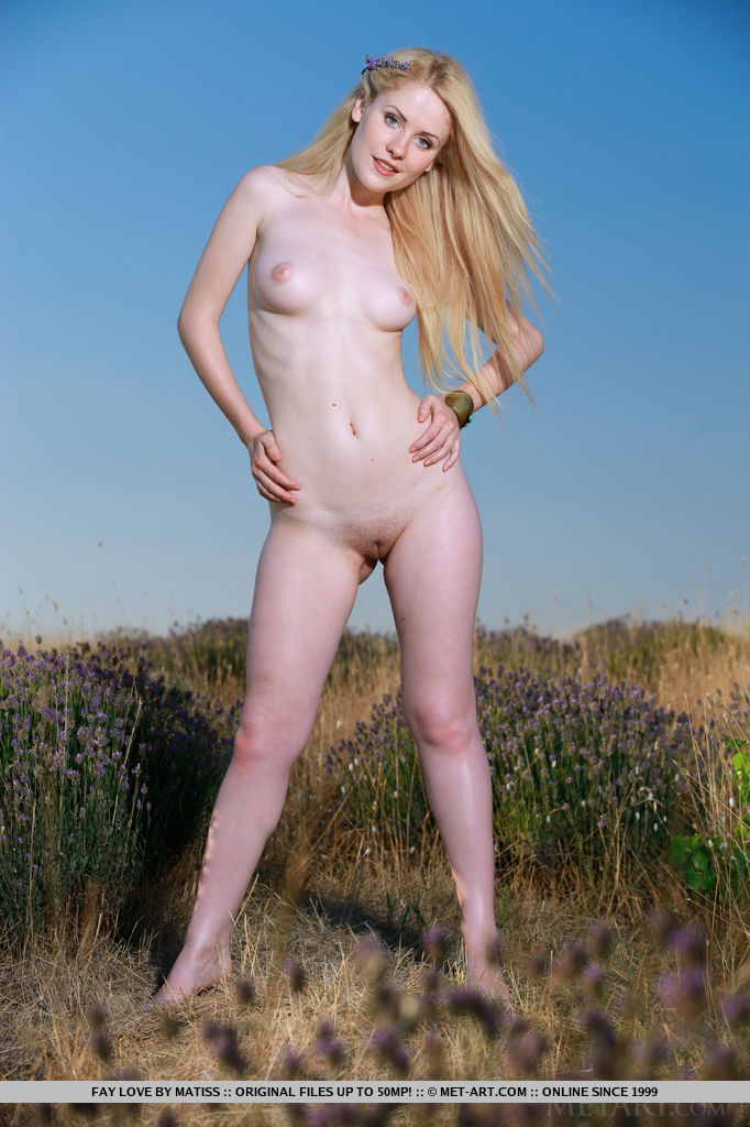 Fay Love s youthful beauty, her smooth porcelain skin, and nubile body stands out in the bright, sunny outdoor.