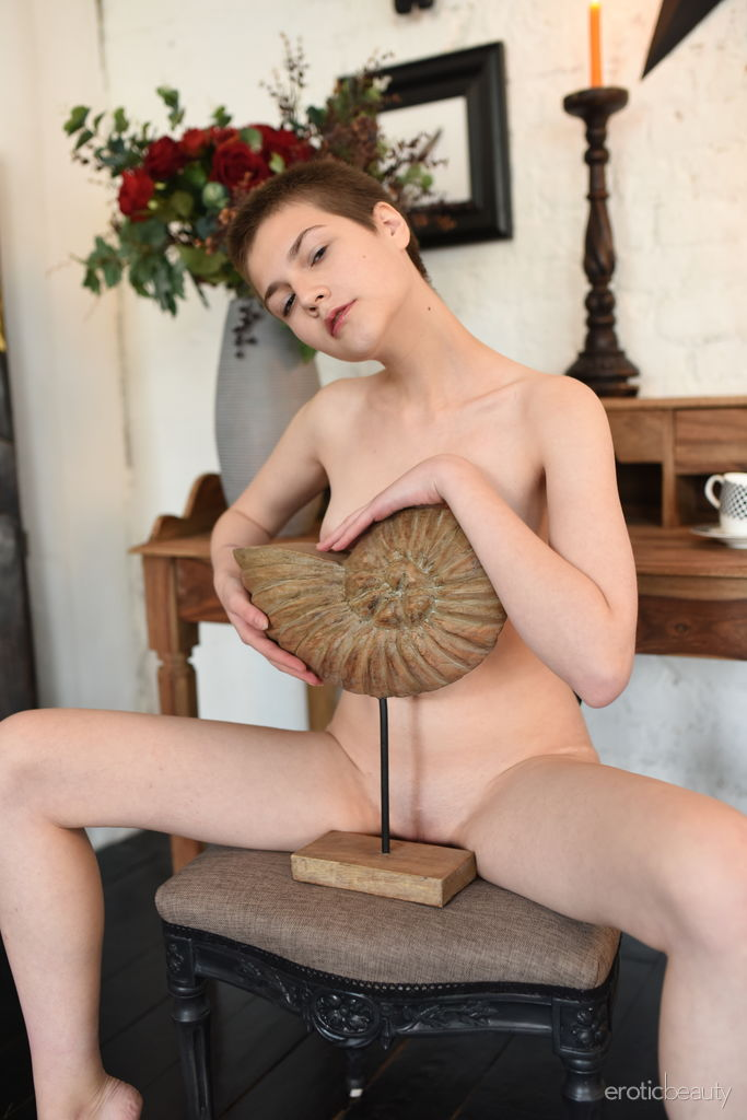 Jerricka strips on the chair as she displays her creamy, slender body.
