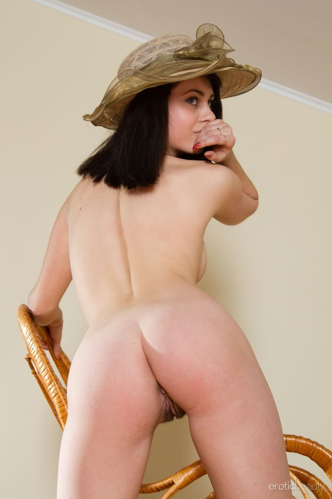 Katya s untrimmed bush compliments her natural and youthful appeal as she poses in front of the camera.
