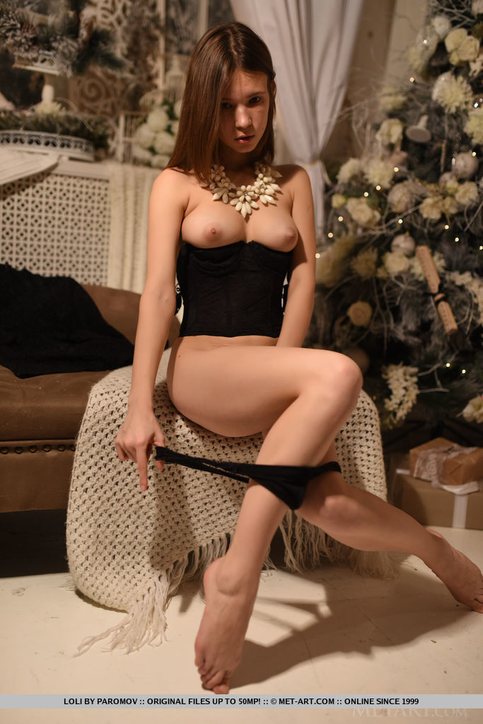 Loli keeps it classy with a private tease as she strip off her black lace dress and matching lingerie as she debuts by the Christmas tree.