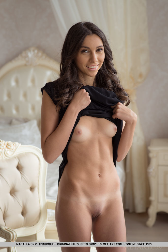 Magali A takes off her elegant black dress and flaunt her tight physique with small but delightfully puffy nipples, toned torso, smooth legs, and an exquisite snatch.
