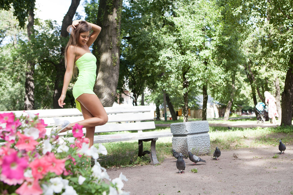 Melena A is pretty and fresh like a breath of Spring. Wearing a  vibrant lime green dress and stiletto heels, she sits down on bench and spreads her legs to expose her luscious, smooth pussy.