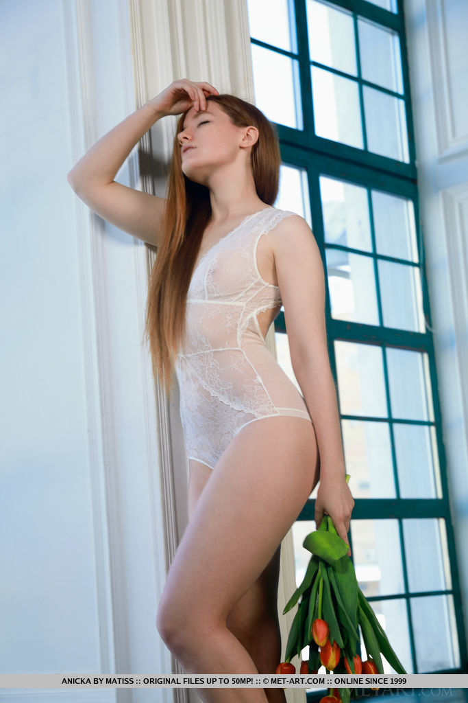 Newcomer Anicka strips by the window as she flaunts her nubile body.