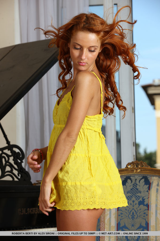 Roberta Berti s bright yellow dress compliments her curly red hair and her perfectly tanned complexion and athletic physique.