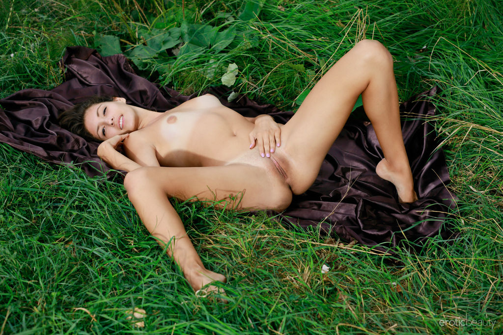 Rosella bares her tanned, nubile body as she strips on the grass.