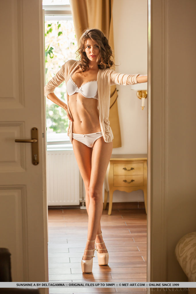 Ginger Frost bares her creamy, slender body as she strips on the bed.