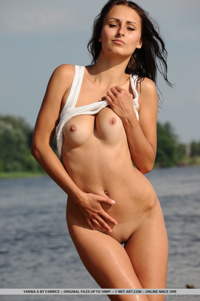 Wet and carefree Yarina A posing her tight body with magnificent assets by the river.