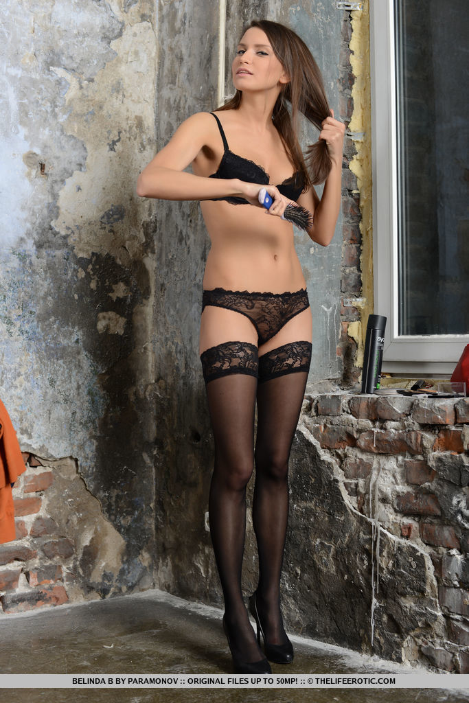 Belinda B shows off her gorgeous curves with a black lace lingerie, matching thigh-high stockings, and black stiletto shoes.