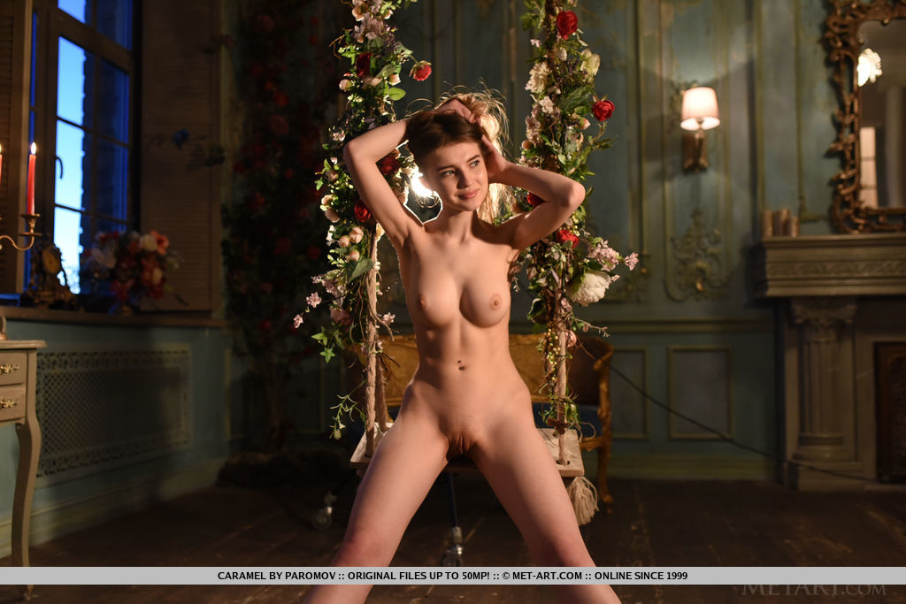 Caramel poses on the swing baring her tight body with perky titties