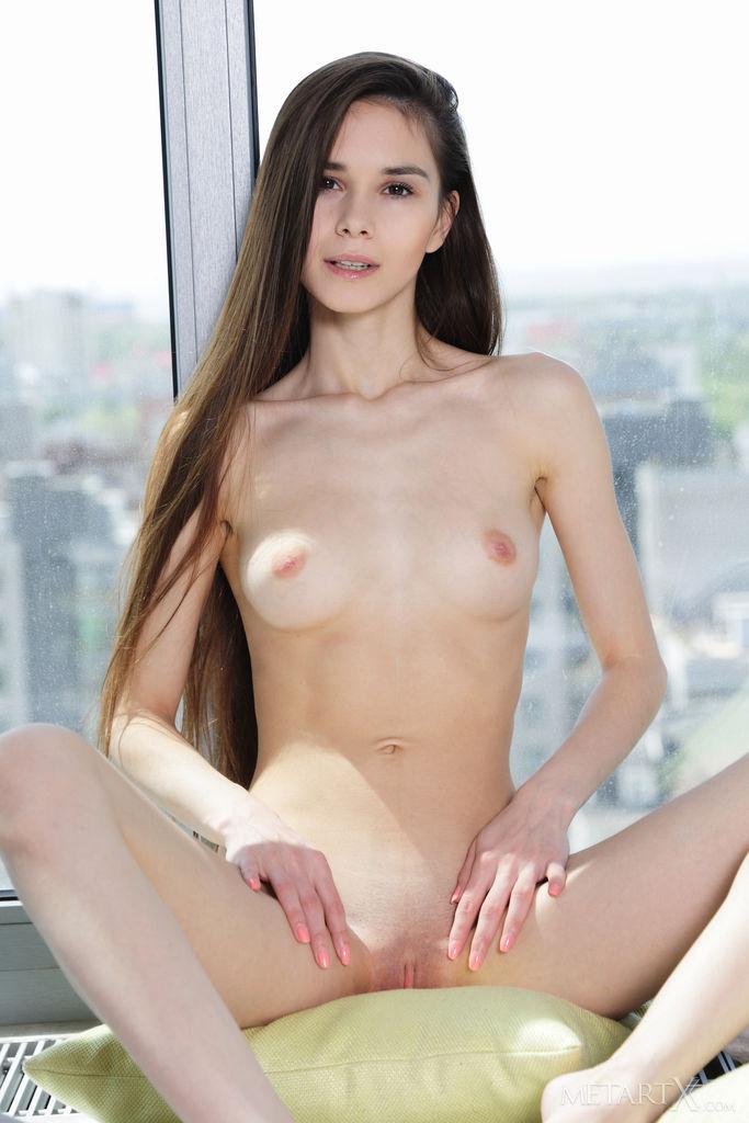 Leona Mia poses dips her fingers into her honeypot to taste her sweet juice