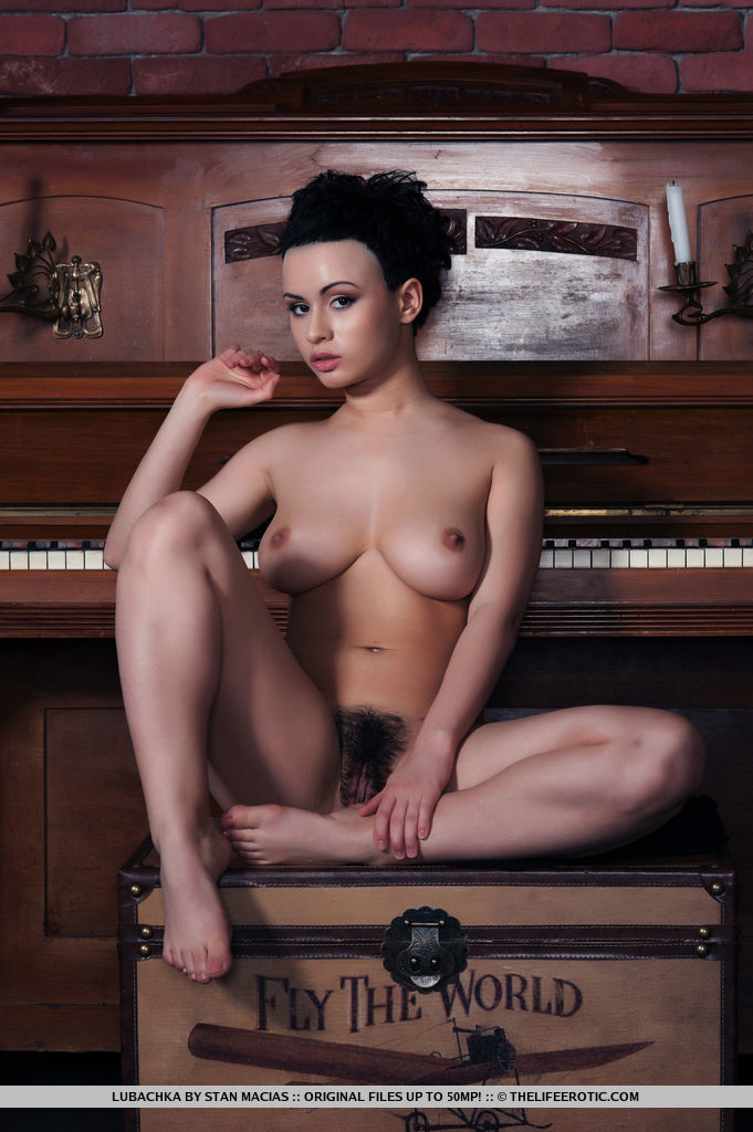 Lubachka makes a titillating performance as she showcase her curvy body with perky nipples and untrimmed bush.