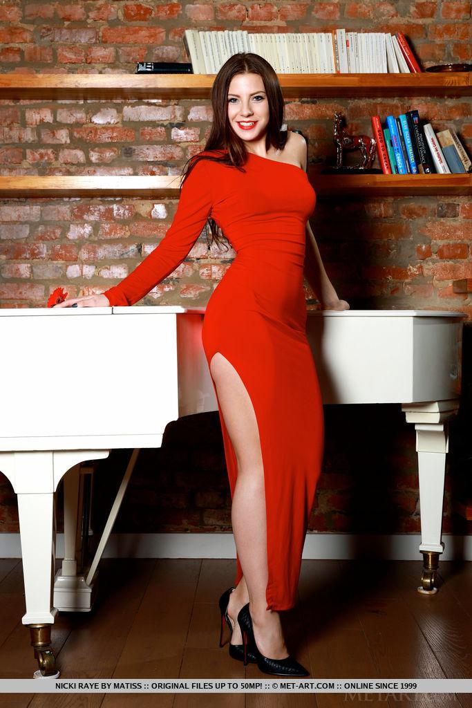 Nicki Raye strips her sexy red dress baring her smoking hot body.