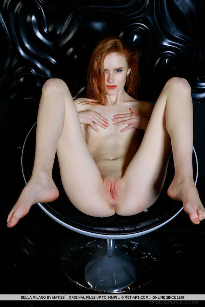 Redhead Bella Milano flaunts her petite, creamy body and pink cherry on the chair.