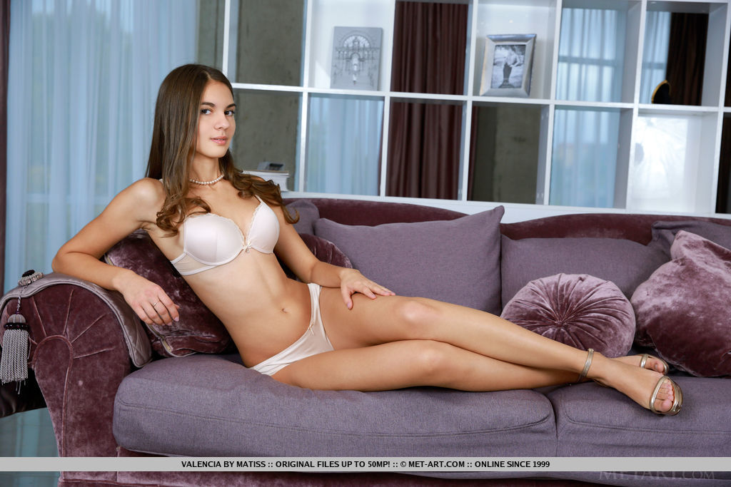 Top model Valencia shows off her delectable body as she poses on the couch.