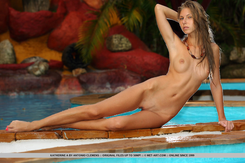 With sultry, provocative eyes, Katherine A loses her white matching bikini and starts posing naked on the pool.