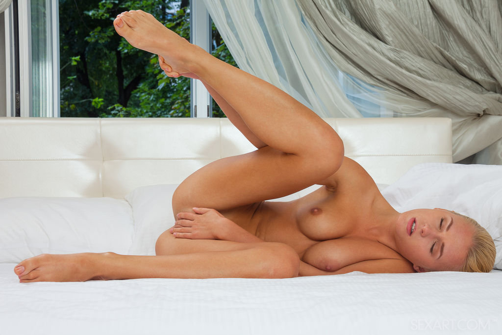 Xena is a stunning nubile nymph who has no inhibitions when it comes to showing off her perfectly proportioned petite body.  She contorts her body in explicit positions while fingering her smooth plump pussy.