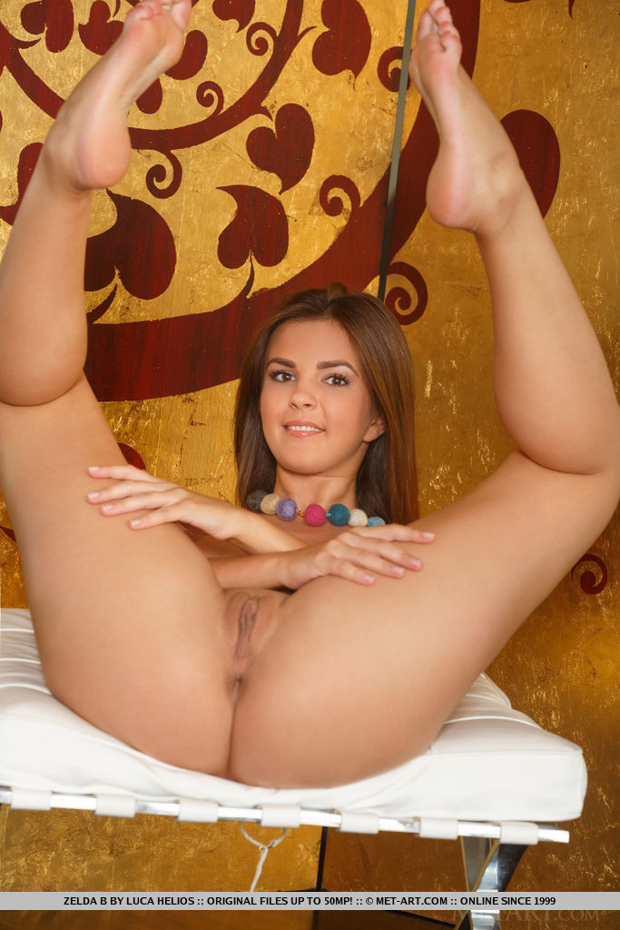 Zelda B bares her tight ass and delectable pussy as she poses in front of the cameara.