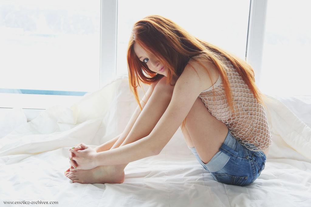 Micca displays her gorgeous body garbed in full body fishnet lingerie then strips her shorts and bares her delectable   assests.