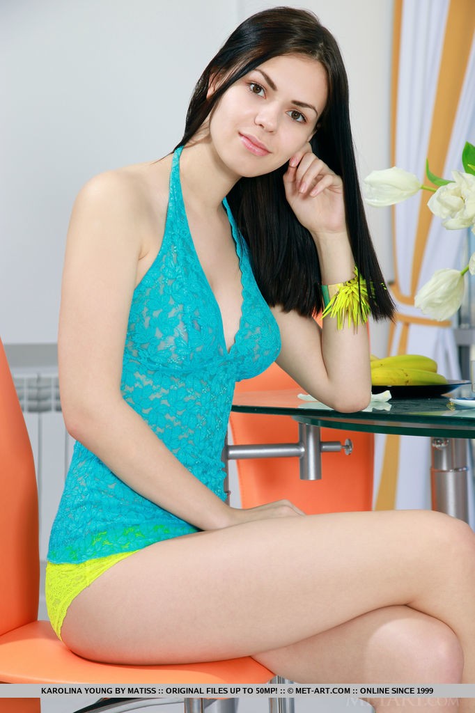 With her warm, vibrant smile coupled by her spontaneous teasing poses, Karolina Young makes a refreshing and stimulating series as she strips her turquoise lace top and bright yellow panty in front of the camera.