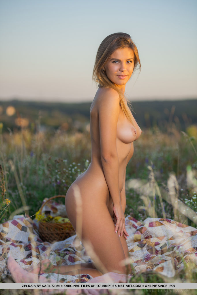 Alluring Zelda B sensually poses among the flowers baring her sexy, slender body.