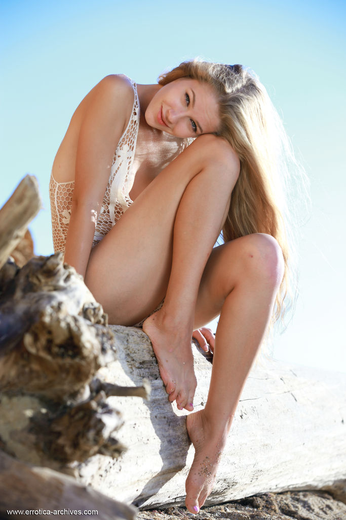 Alluring blonde Genevieve Gandi bares her delectable body outdoors.