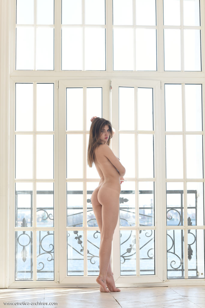 Caramel poses by the window as she bares her delectable body.