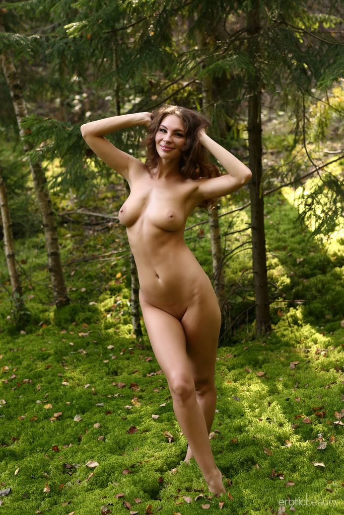 Galina A flaunts her amazing physique as she playfully poses in the woods
