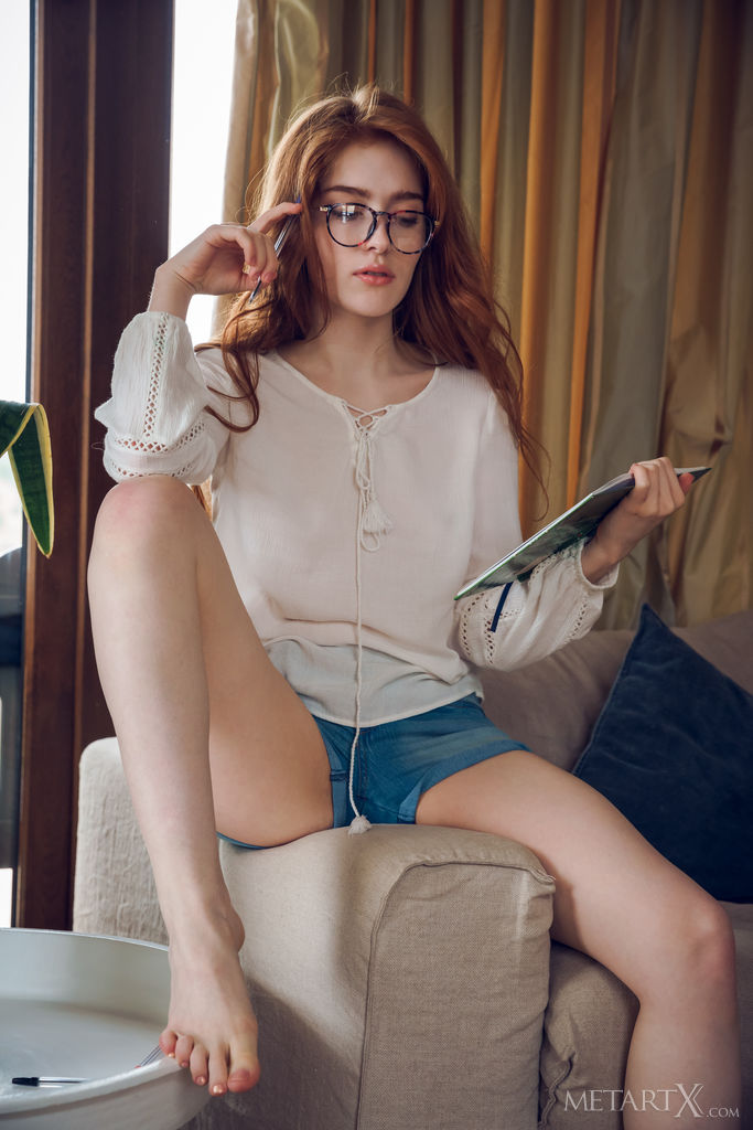 Jia Lissa plays the studious yet naughty co-ed, playfully posing for the camera while studying